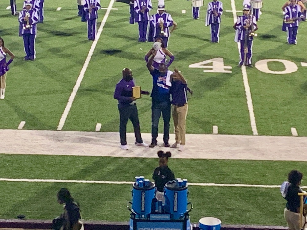 """Humbling...very honored."" Fairfield alum & pro football retiree honored during homecoming"