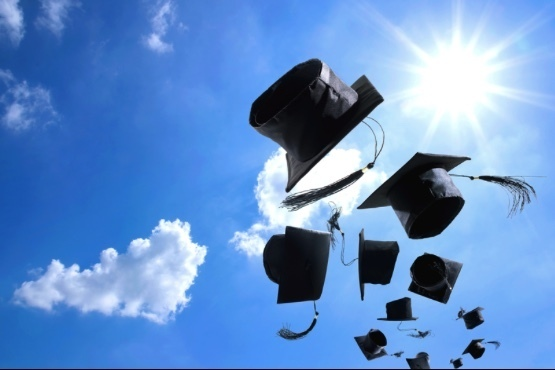 Graduation hats to sky